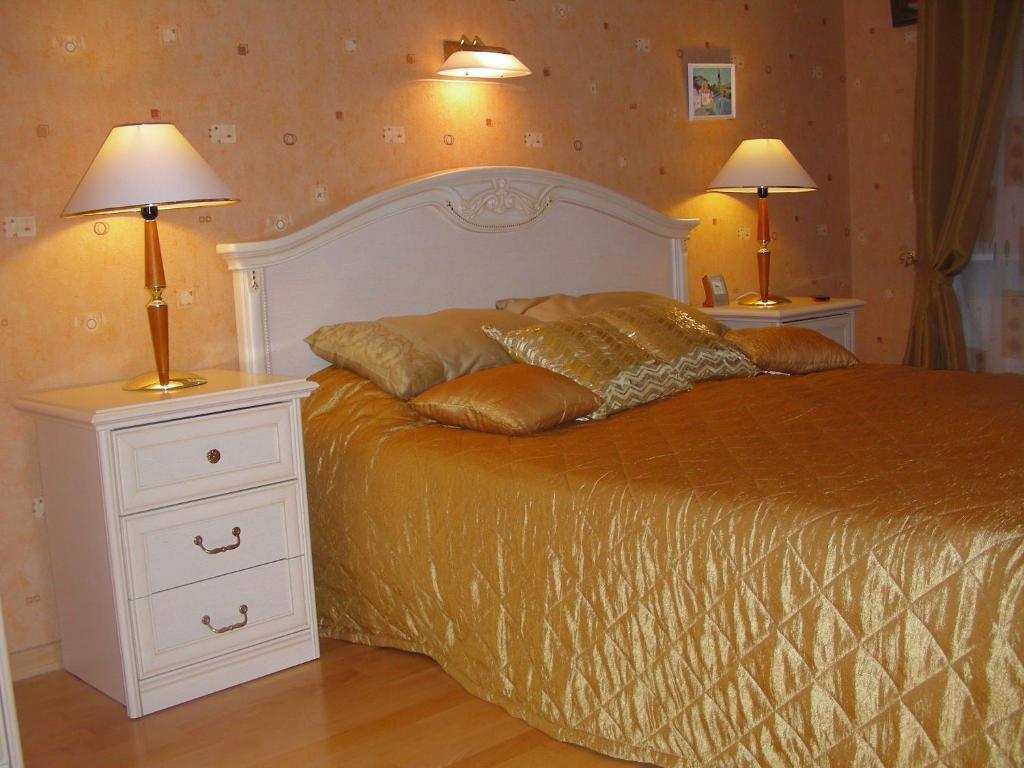 Кровать или кровати в номере Apartment on Malaya Posadskaya