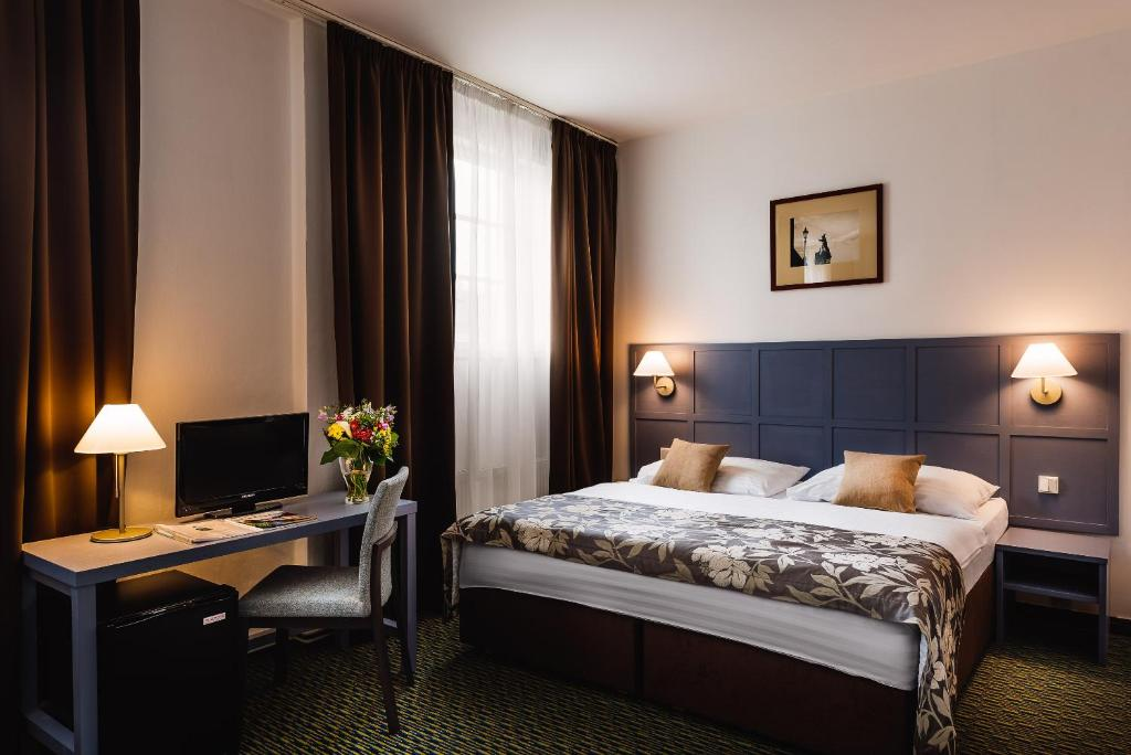 A bed or beds in a room at Central Hotel Prague