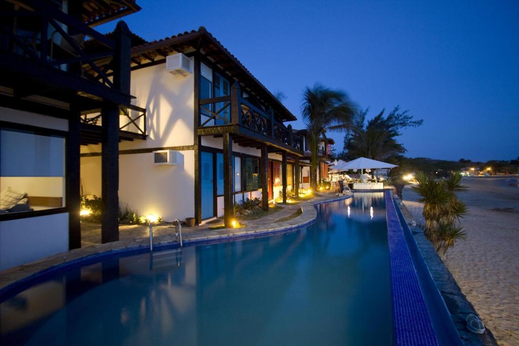 A piscina localizada em Chez Pitu Praia Hotel ou nos arredores