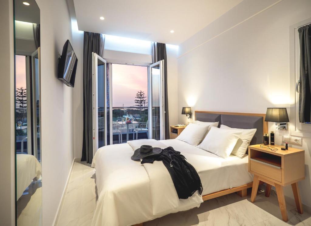 Ένα ή περισσότερα κρεβάτια σε δωμάτιο στο Elysian Suites