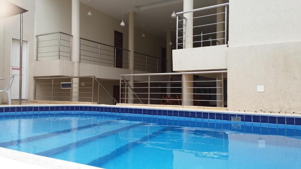 The swimming pool at or near Hana Praia Hotel