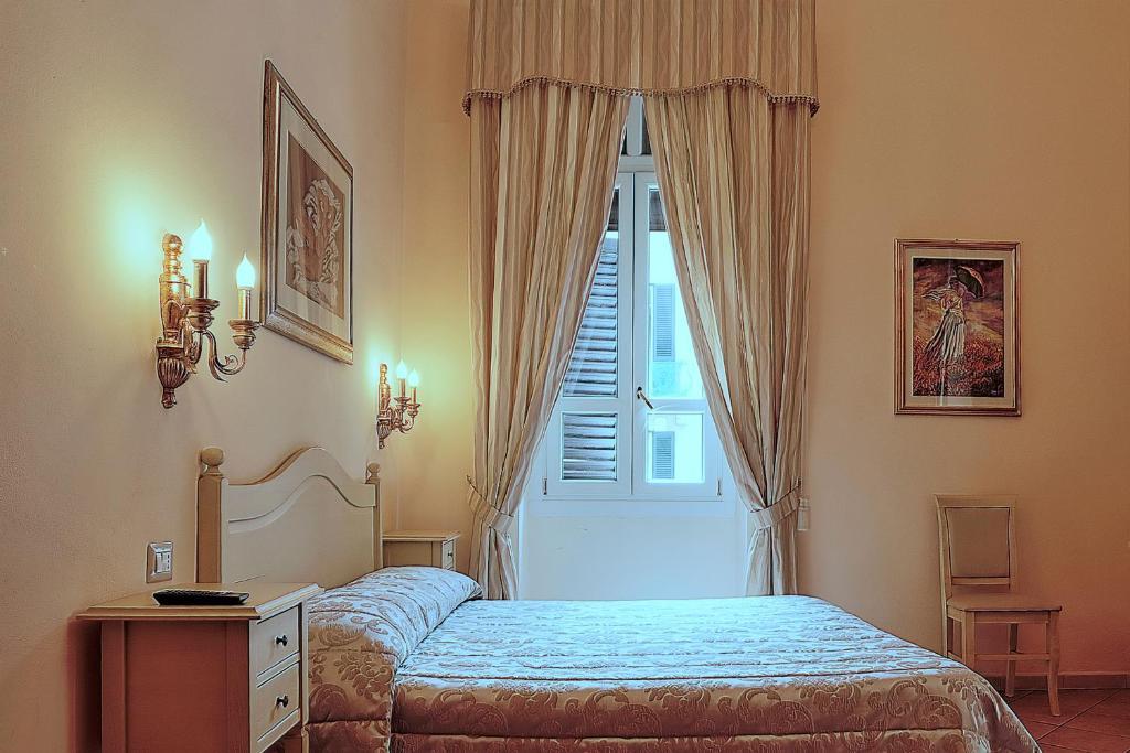 A bed or beds in a room at Chiaro Di Luna