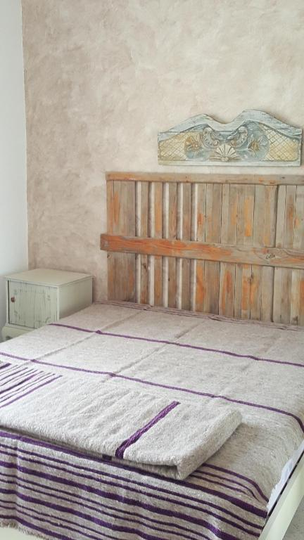 A bed or beds in a room at Résidence LA VILLA