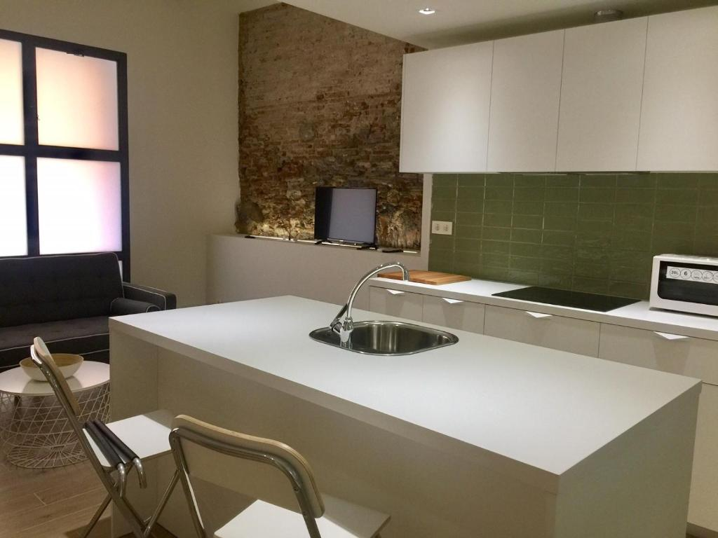 A kitchen or kitchenette at Apartamento Cambrils