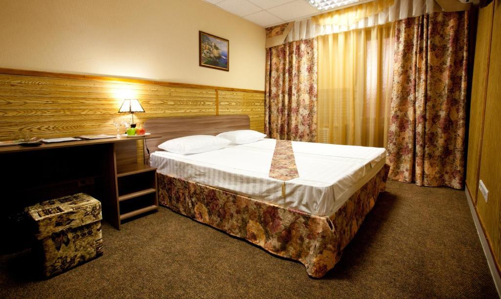A bed or beds in a room at Hotel Nataly on Srednemoskovskaya 7