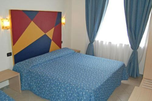 Letto o letti in una camera di Mare Blu