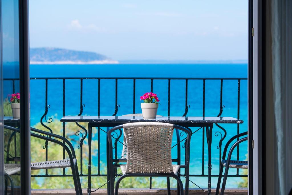 A balcony or terrace at Kalliston Beach Apartments