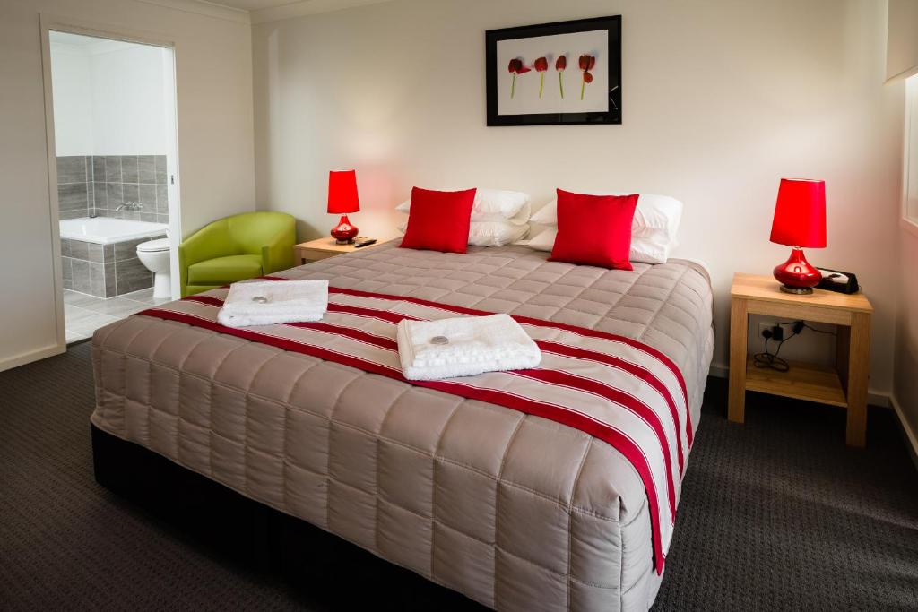 A bed or beds in a room at Wallsend Executive Apartments