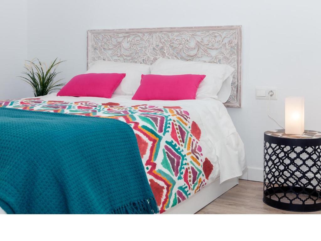 Cama o camas de una habitación en Apartamentos Rey Moro