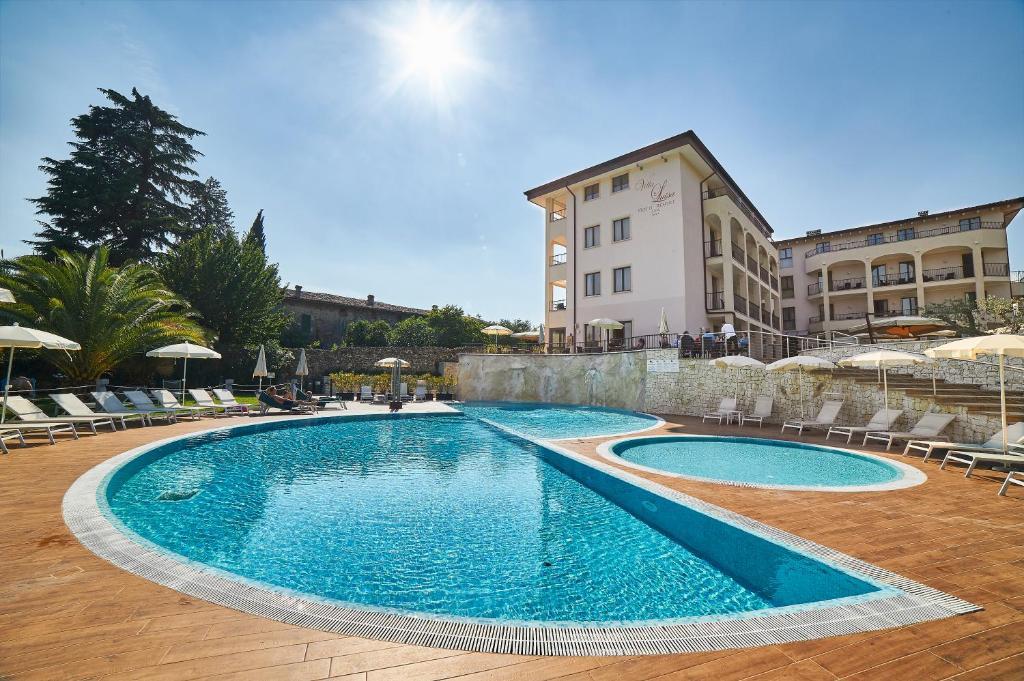 The swimming pool at or near Hotel Resort Villa Luisa & Spa