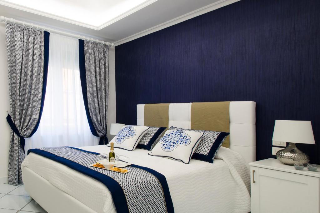Letto o letti in una camera di B&B Maiori Luxury