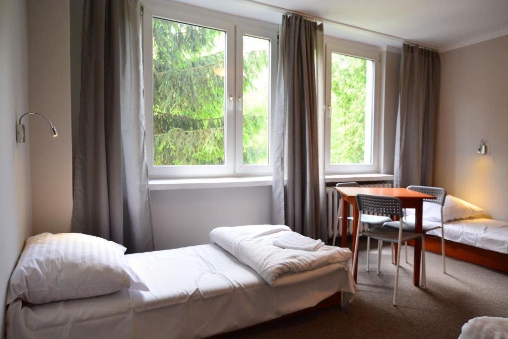 Posteľ alebo postele v izbe v ubytovaní NH Hostel - TBN House