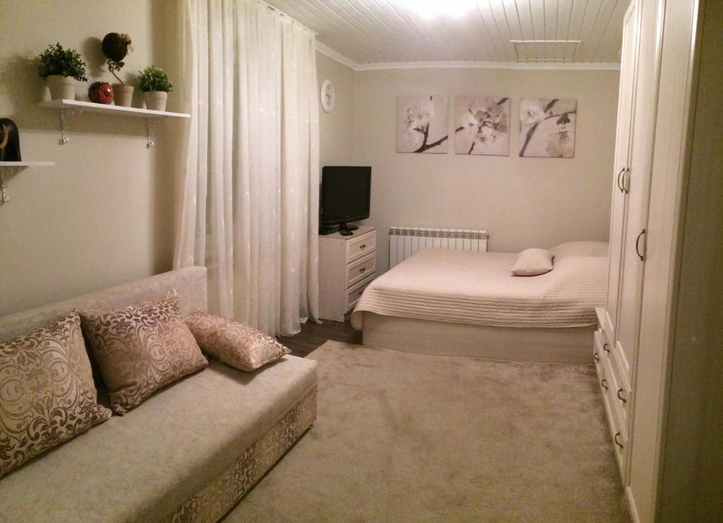 Кровать или кровати в номере Апартаменты на Пушкина,д.12