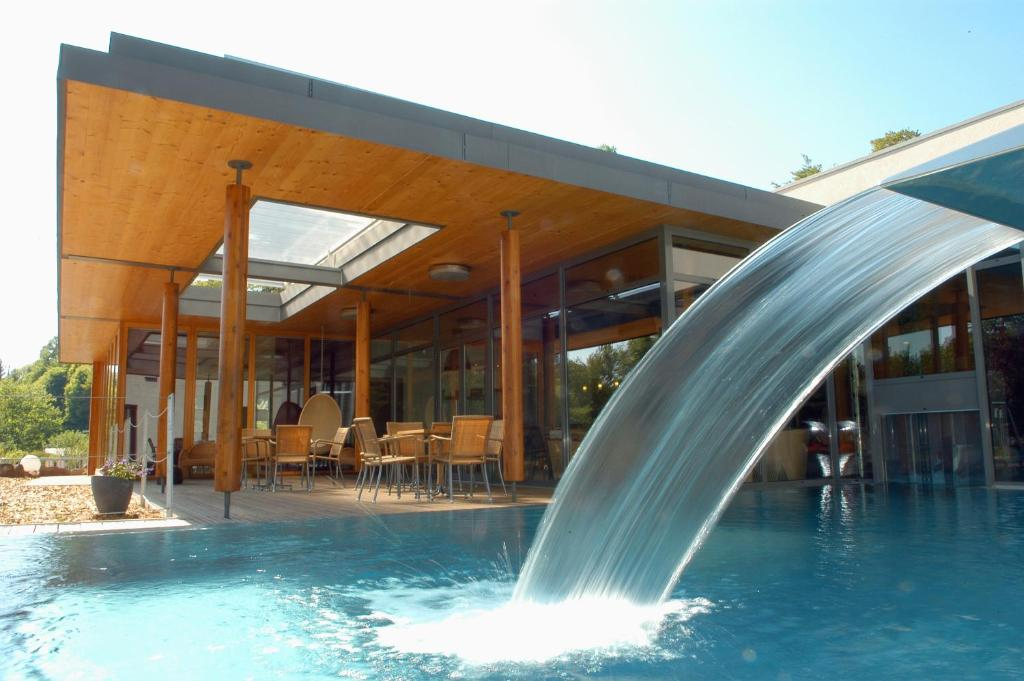 The swimming pool at or near La Clairière bio & spahotel