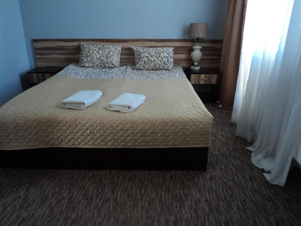 Ліжко або ліжка в номері Hotel Restaurant Vizit