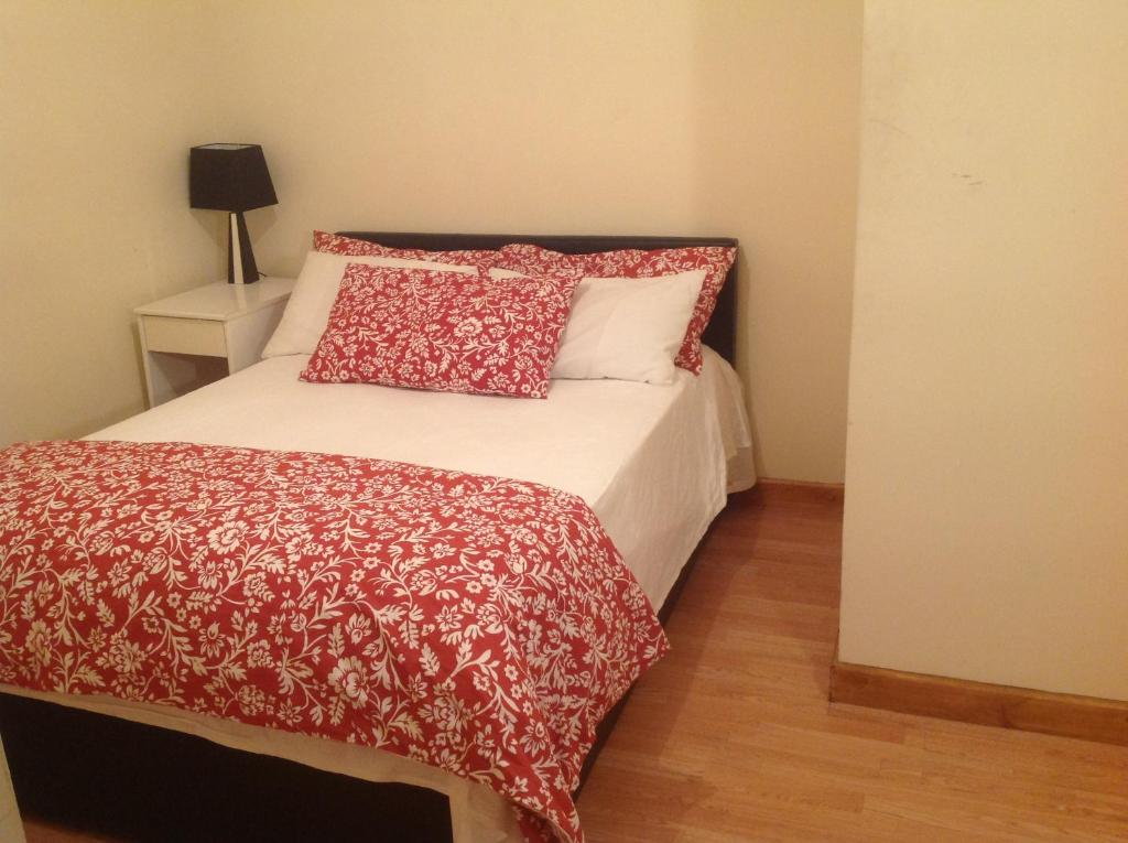 A bed or beds in a room at Nky Apartment