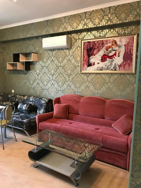 Гостиная зона в Apartment on Volzhskaya 42-3
