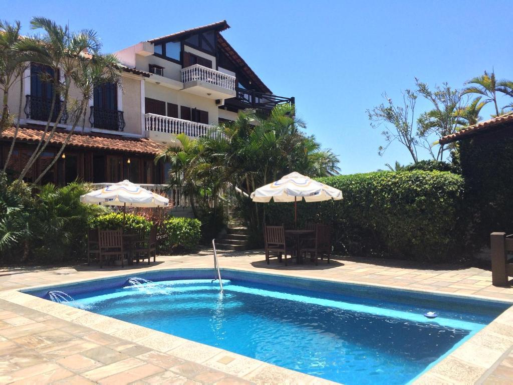 A piscina localizada em Pousada Caminho do Sol ou nos arredores