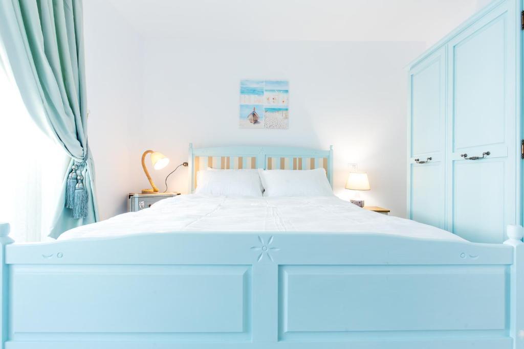 מיטה או מיטות בחדר ב-The Shore House