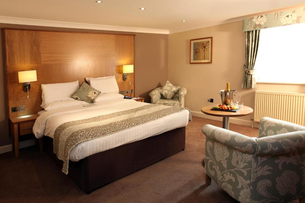 A bed or beds in a room at Best Western Premier East Midlands Airport Yew Lodge Hotel