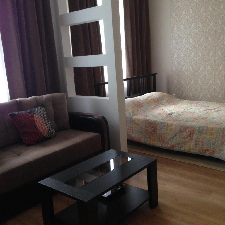 A bed or beds in a room at Apartment on Mironenko