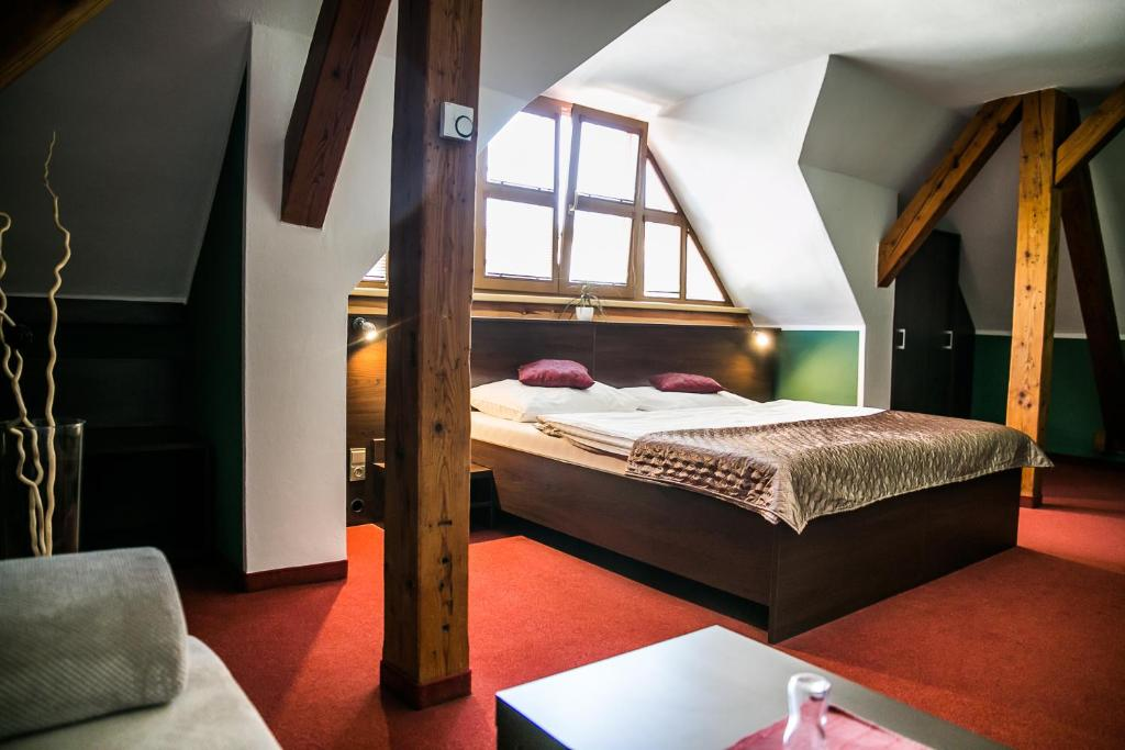 A bed or beds in a room at Hotel Best
