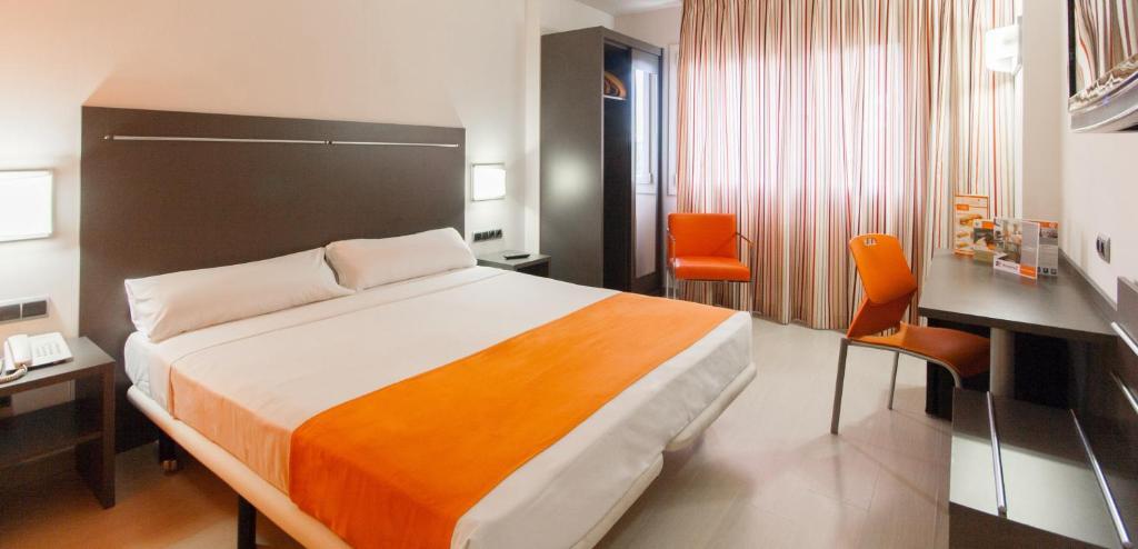 Кровать или кровати в номере H2 Fuenlabrada