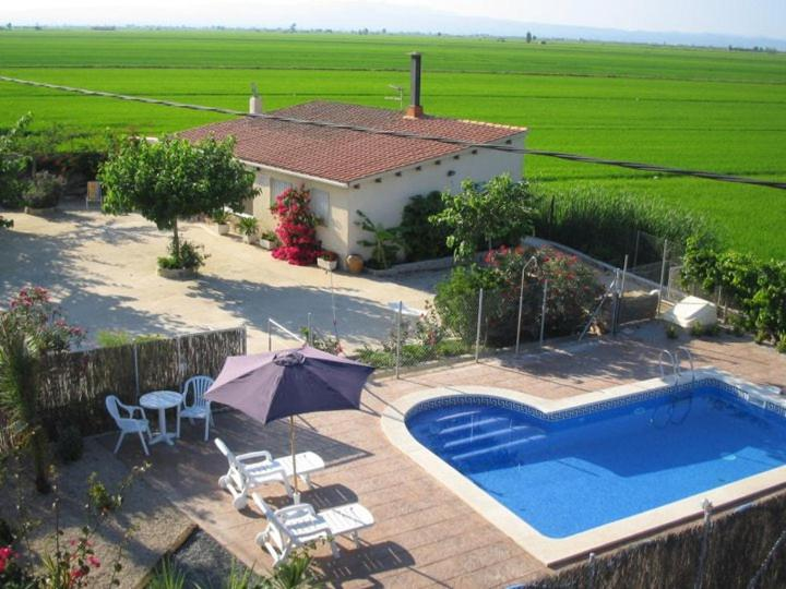 A view of the pool at Caseta del Chato or nearby