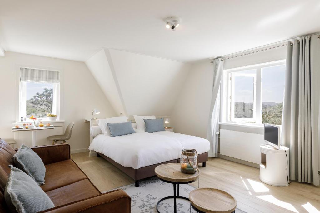 Een bed of bedden in een kamer bij Villa Parnassia