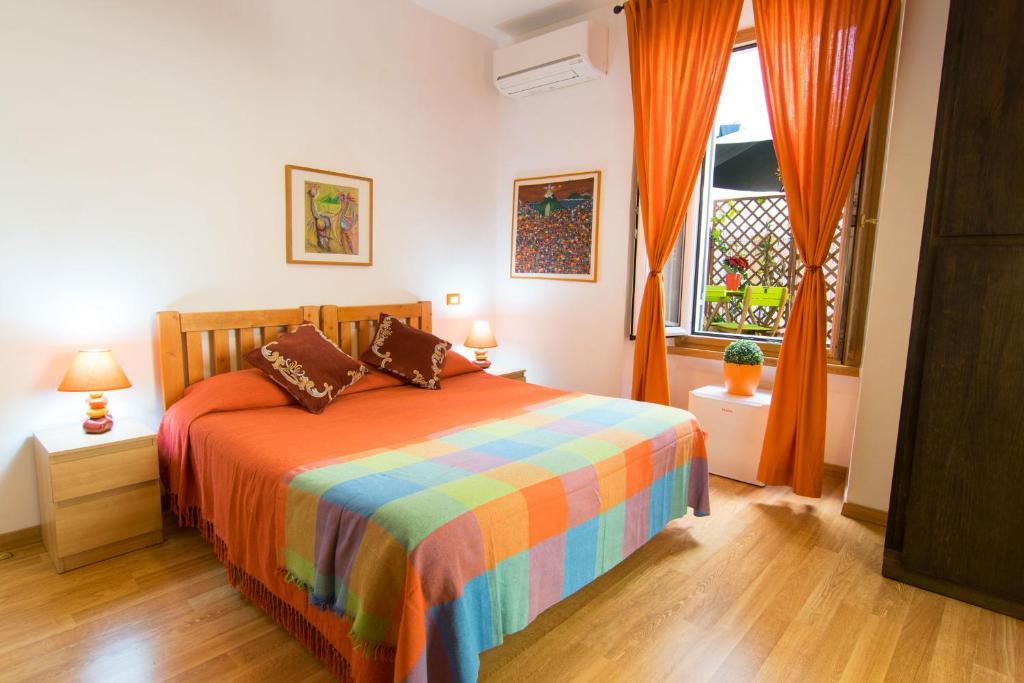 Cama ou camas em um quarto em Maison Vaticana