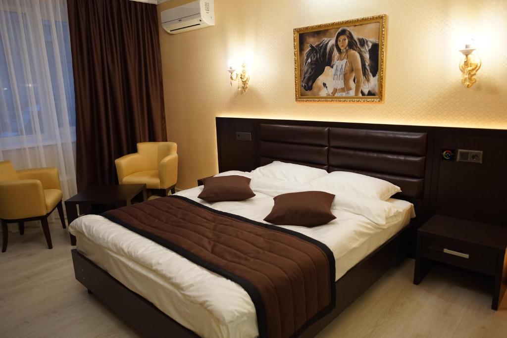 Кровать или кровати в номере Отель Колибри