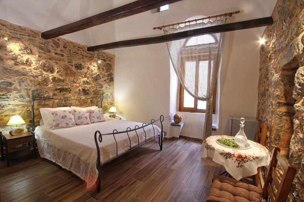 Ένα ή περισσότερα κρεβάτια σε δωμάτιο στο Schinos Apartments