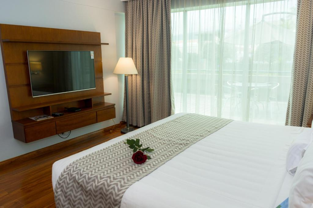 A bed or beds in a room at Aparta Hotel Torres de Suites