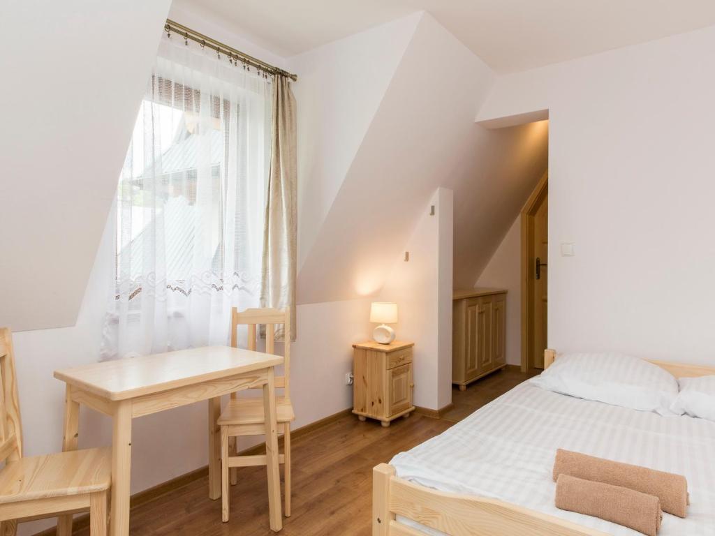 A bed or beds in a room at Pokoje Gościnne Bachledzki Wierch