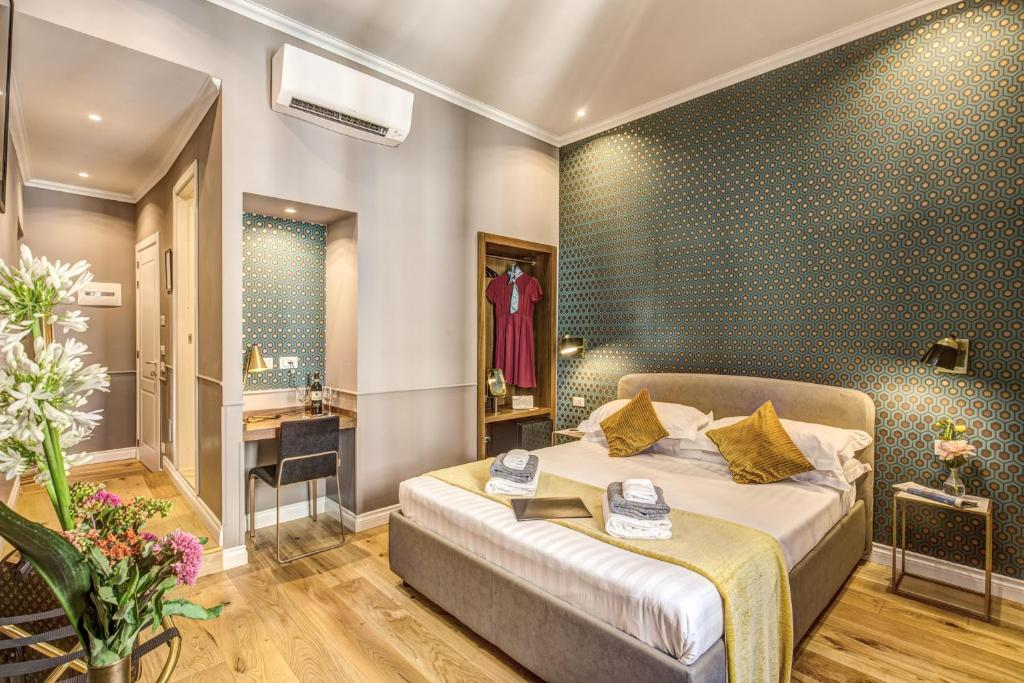 Łóżko lub łóżka w pokoju w obiekcie Charme Spagna Boutique Hotel