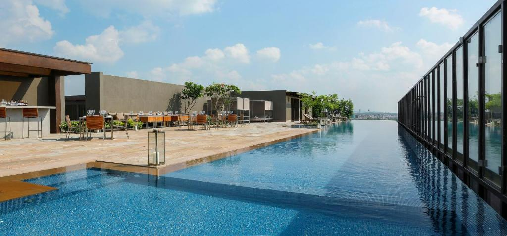The swimming pool at or near Roseate House New Delhi