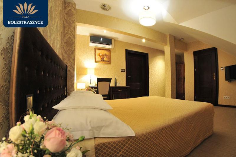 Łóżko lub łóżka w pokoju w obiekcie Hotel Villa Bolestraszyce