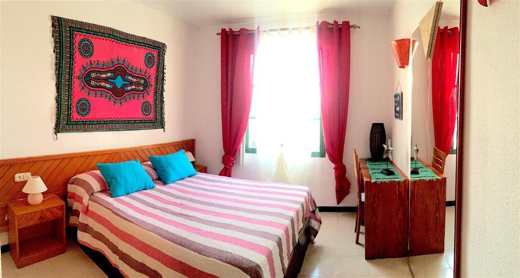 Cama o camas de una habitación en Fuertelena Ocean In Love Apartment