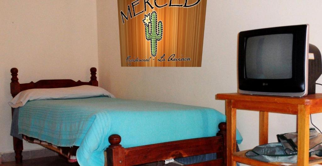 A bed or beds in a room at Merced Residencial