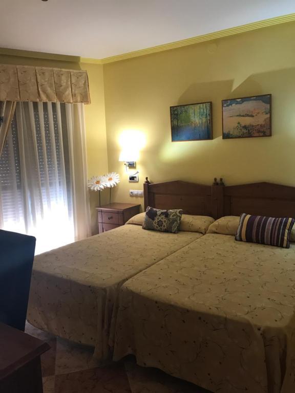 Cama o camas de una habitación en Hotel Lucero