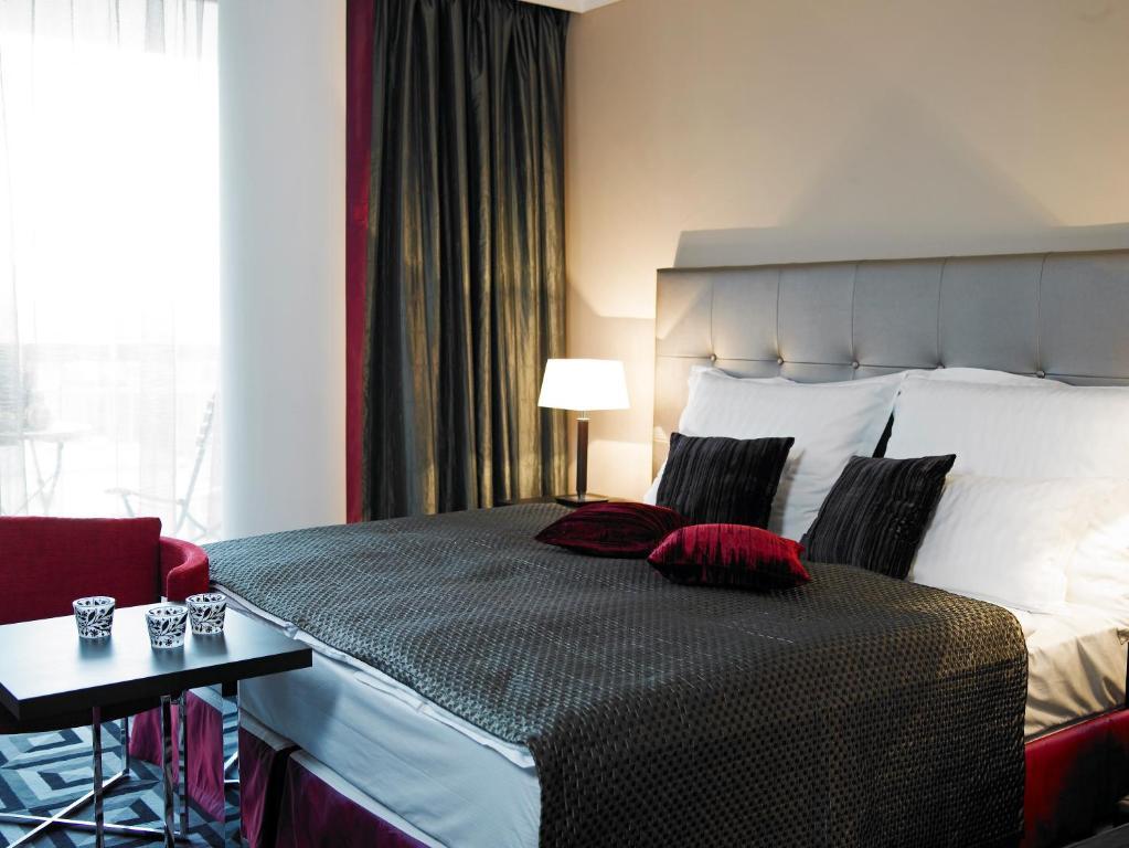 Кровать или кровати в номере Hotel Belvedere Budapest