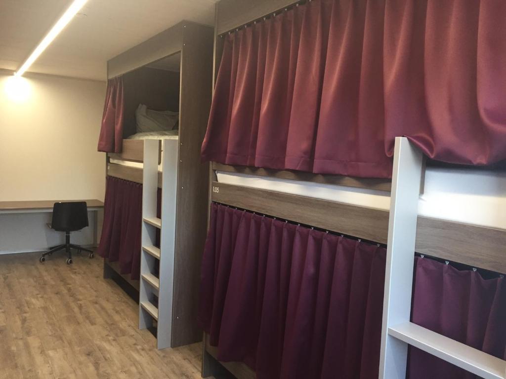 Un ou plusieurs lits superposés dans un hébergement de l'établissement Auberge du Guintzet