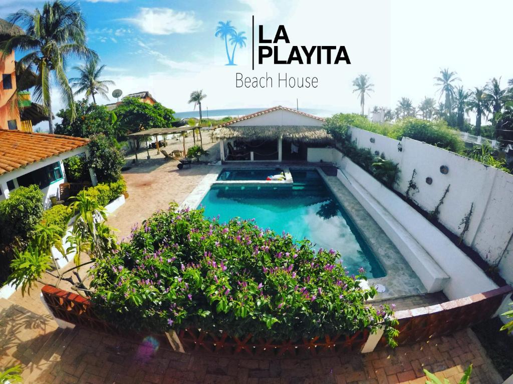 A view of the pool at La Playita Beach House or nearby