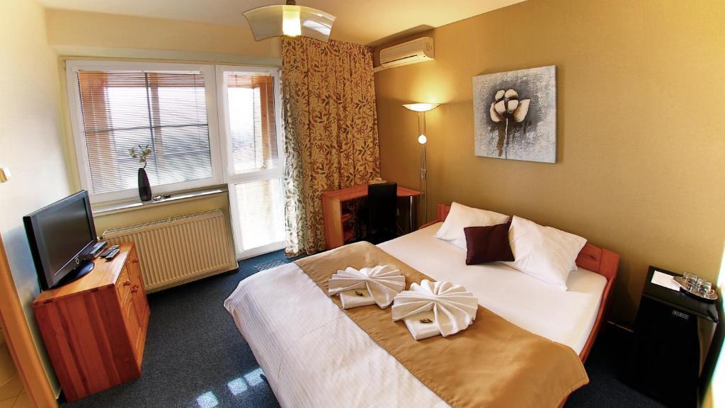 Posteľ alebo postele v izbe v ubytovaní Penzion Tofi