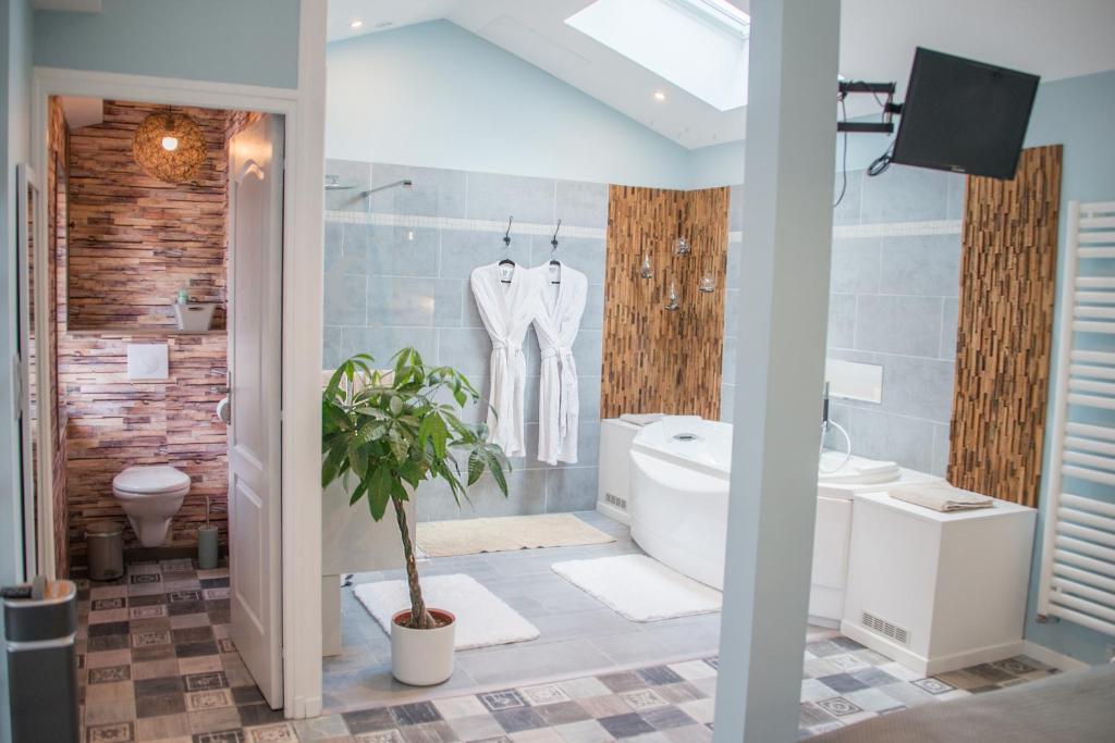Salle de bains dans l'établissement L'Intemporel
