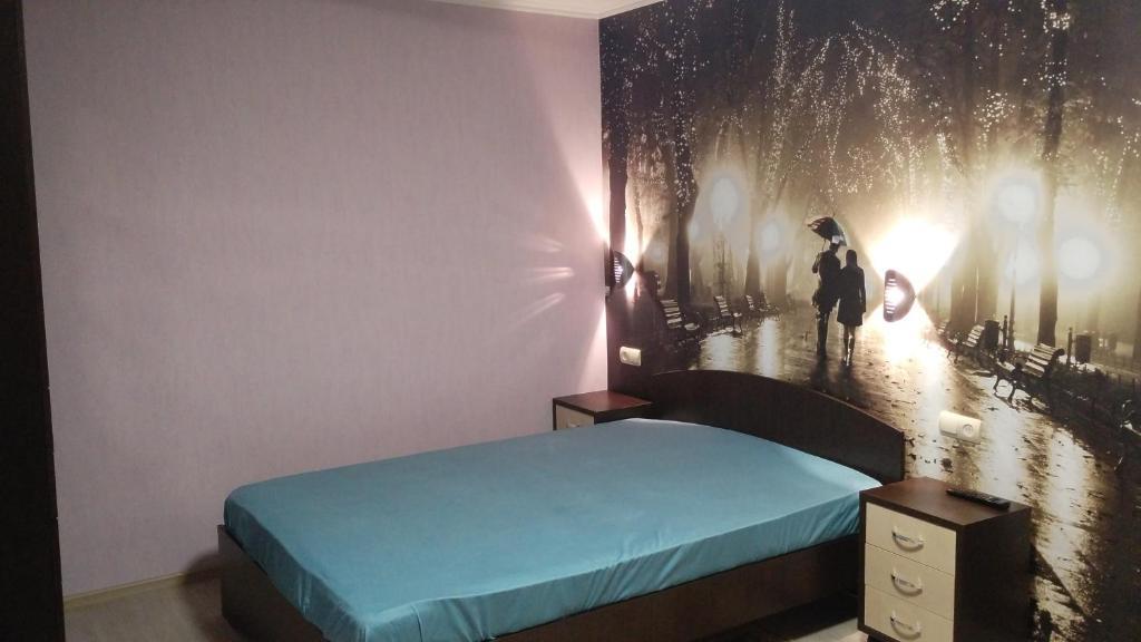 Кровать или кровати в номере Apartments at Moskovskaya 20