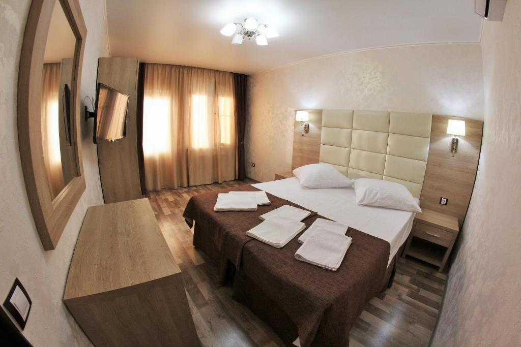 Кровать или кровати в номере Гостевой дом Шоколад