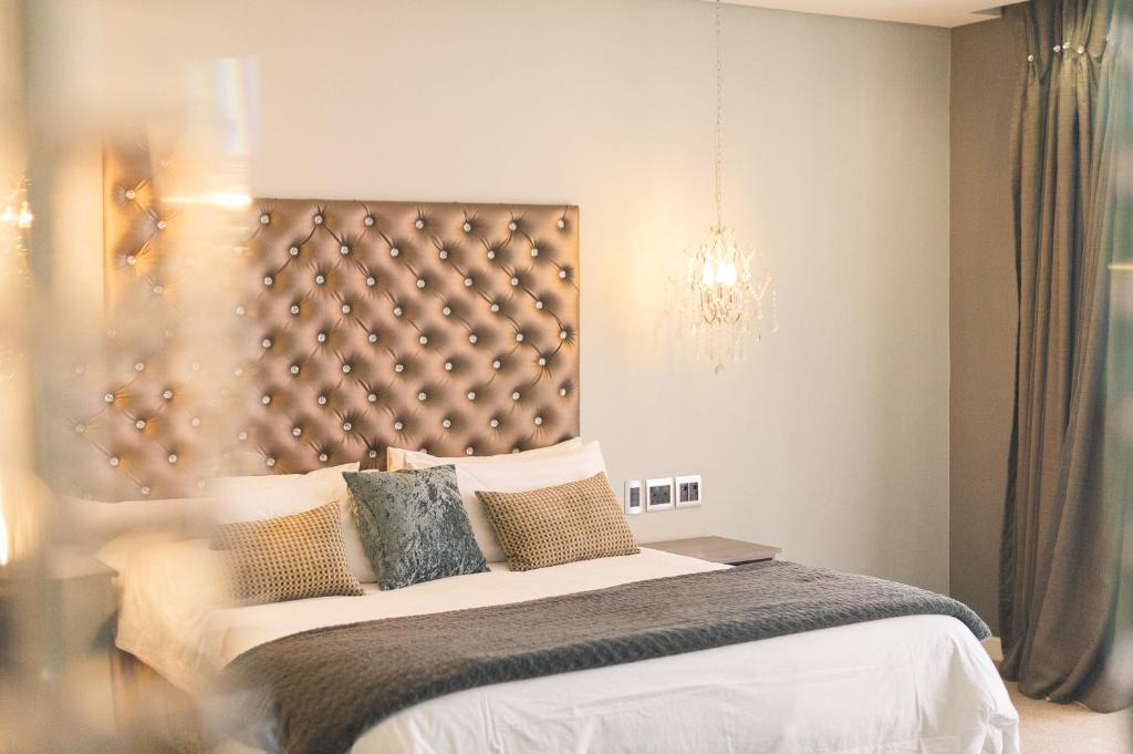 A bed or beds in a room at Blue Diamond Boutique Hotel
