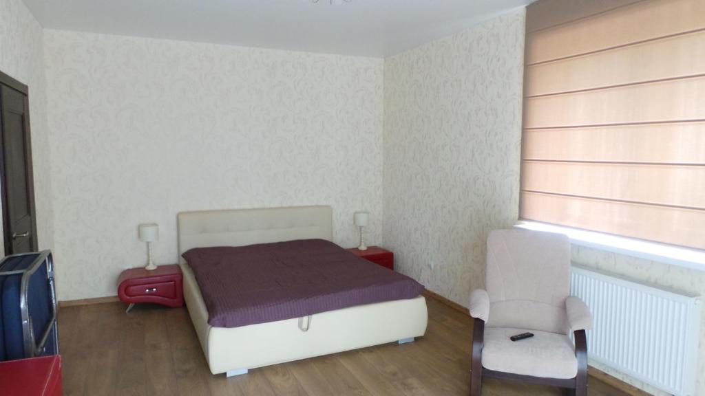 Кровать или кровати в номере Апартаменты на Ленина 32