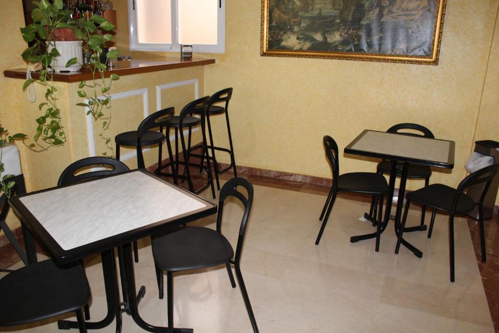 Un restaurante o sitio para comer en Hotel Albohera